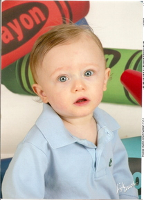 oil portrait of a baby boy in a light blue shirt