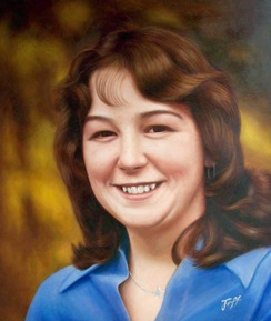 memorial oil portrait of a woman in blue shirt
