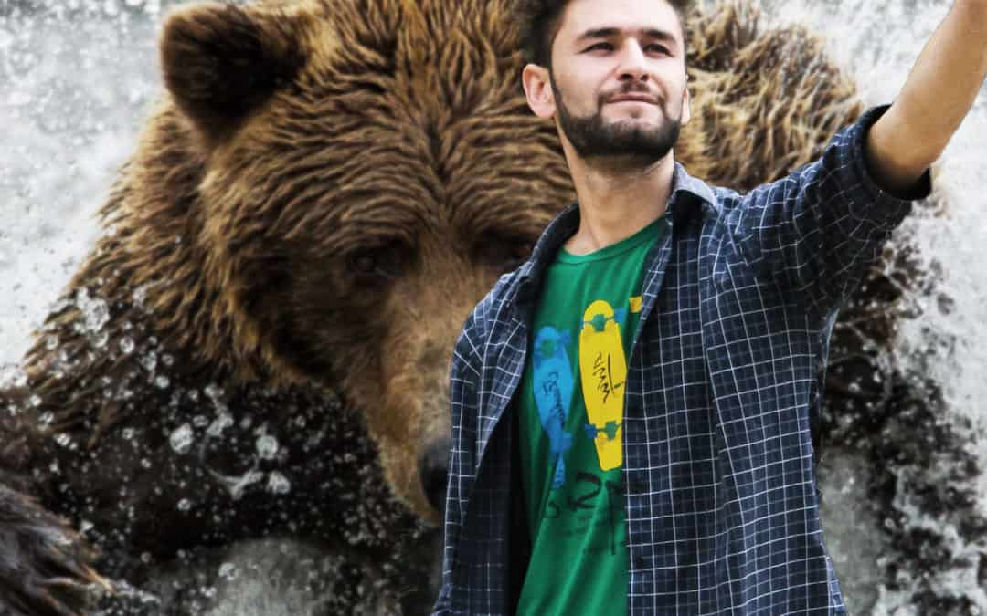Idiot Who Waded into a River Full of Hungry Bears For a Selfie Didn't Die, But is Facing Charges