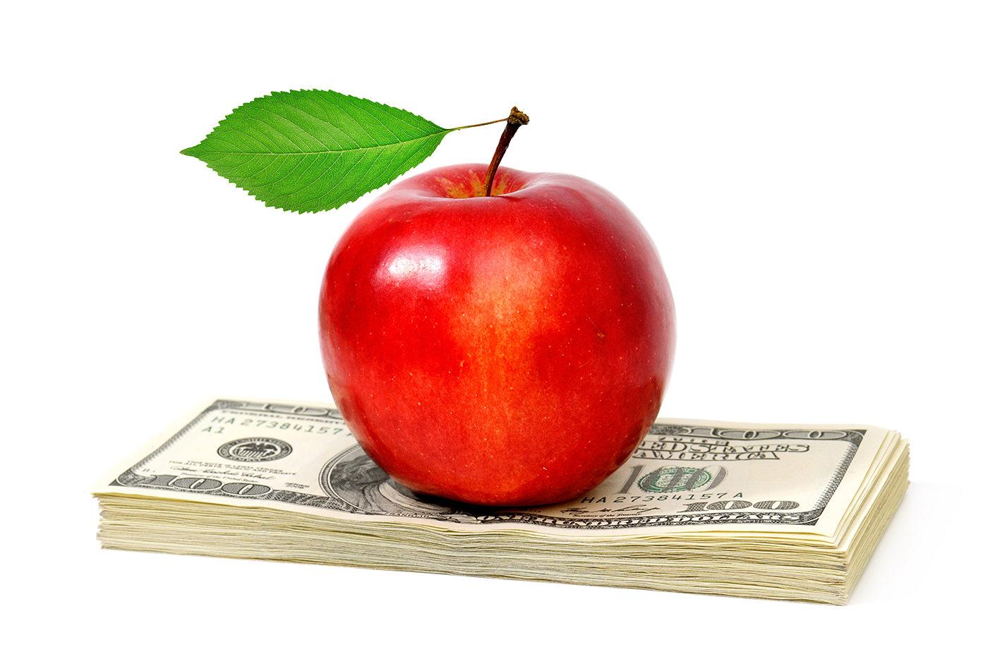 apple on a stack of money becoming financial health