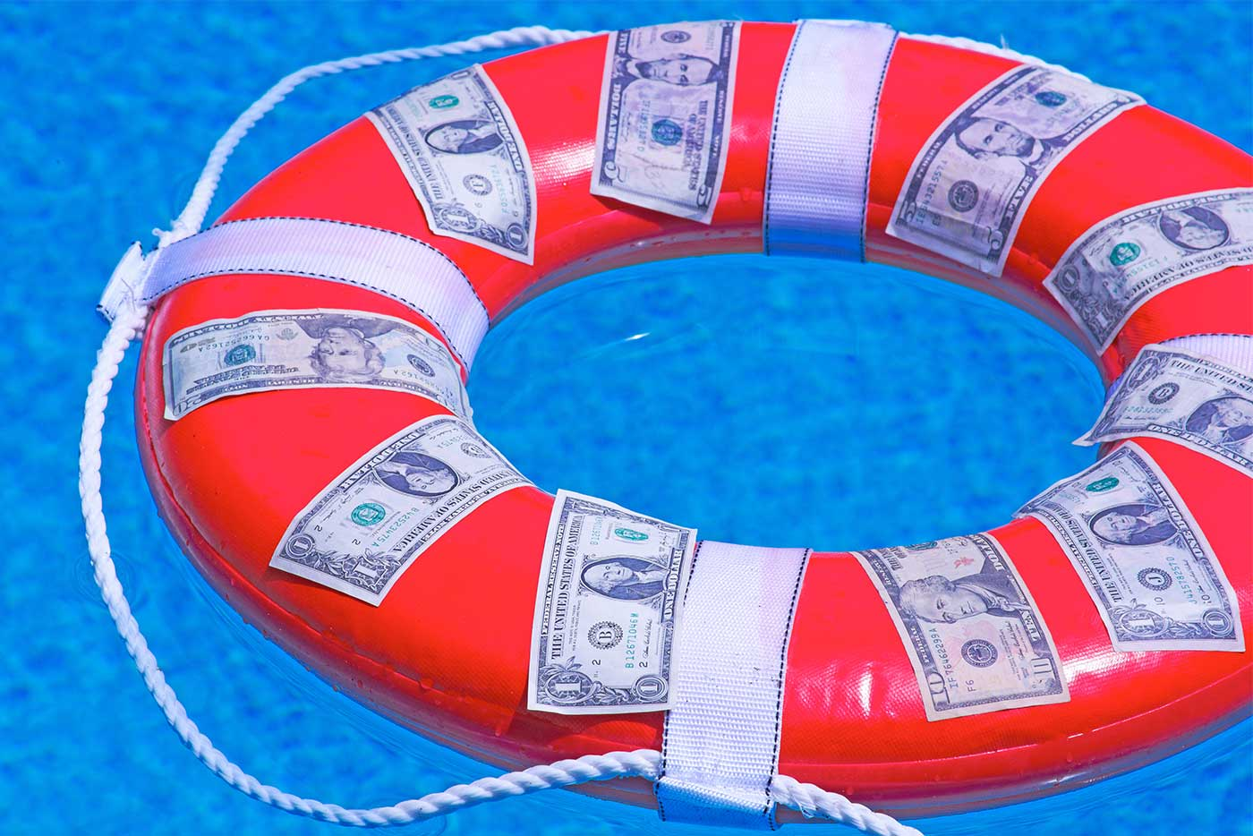 Buoy with American money on it symbolizes emergency fund for financial security