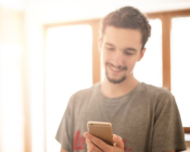 Millennial smiling looking at phone