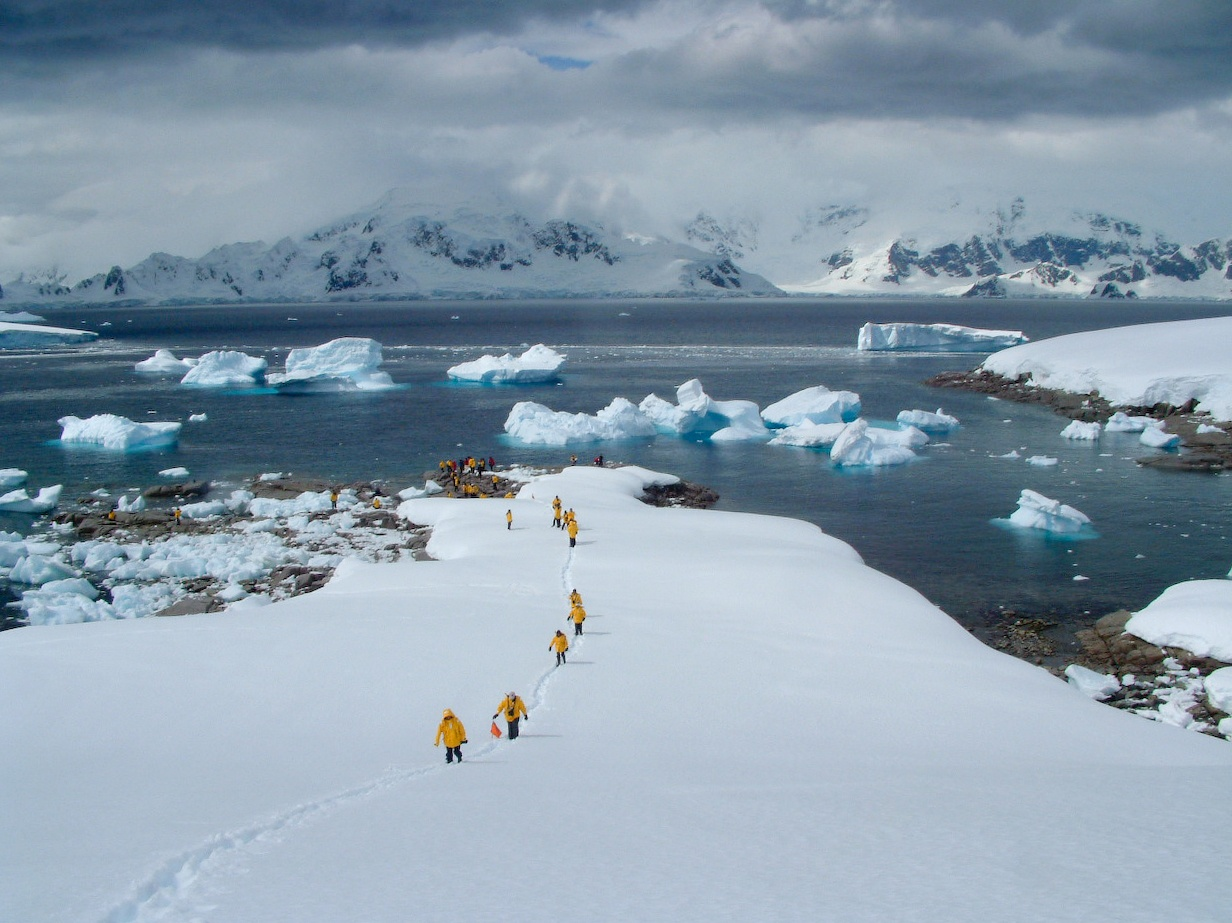 Passengers hike the rugged Antarctic Peninsula on a shore landing.