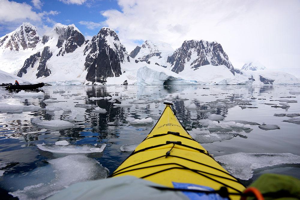 kayaking through icebergs in Antarctica