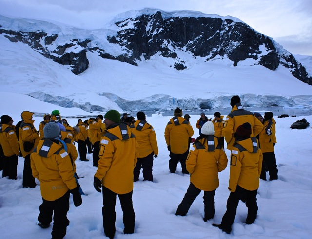 A group of adventurous Quark passengers at their Antarctic camping safety briefing.