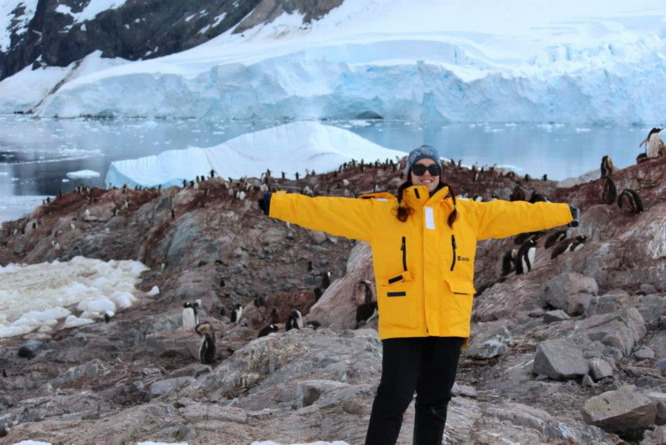 Quark passenger Corina Hitchcock takes in the view in front of a penguin colony in Antarctica.