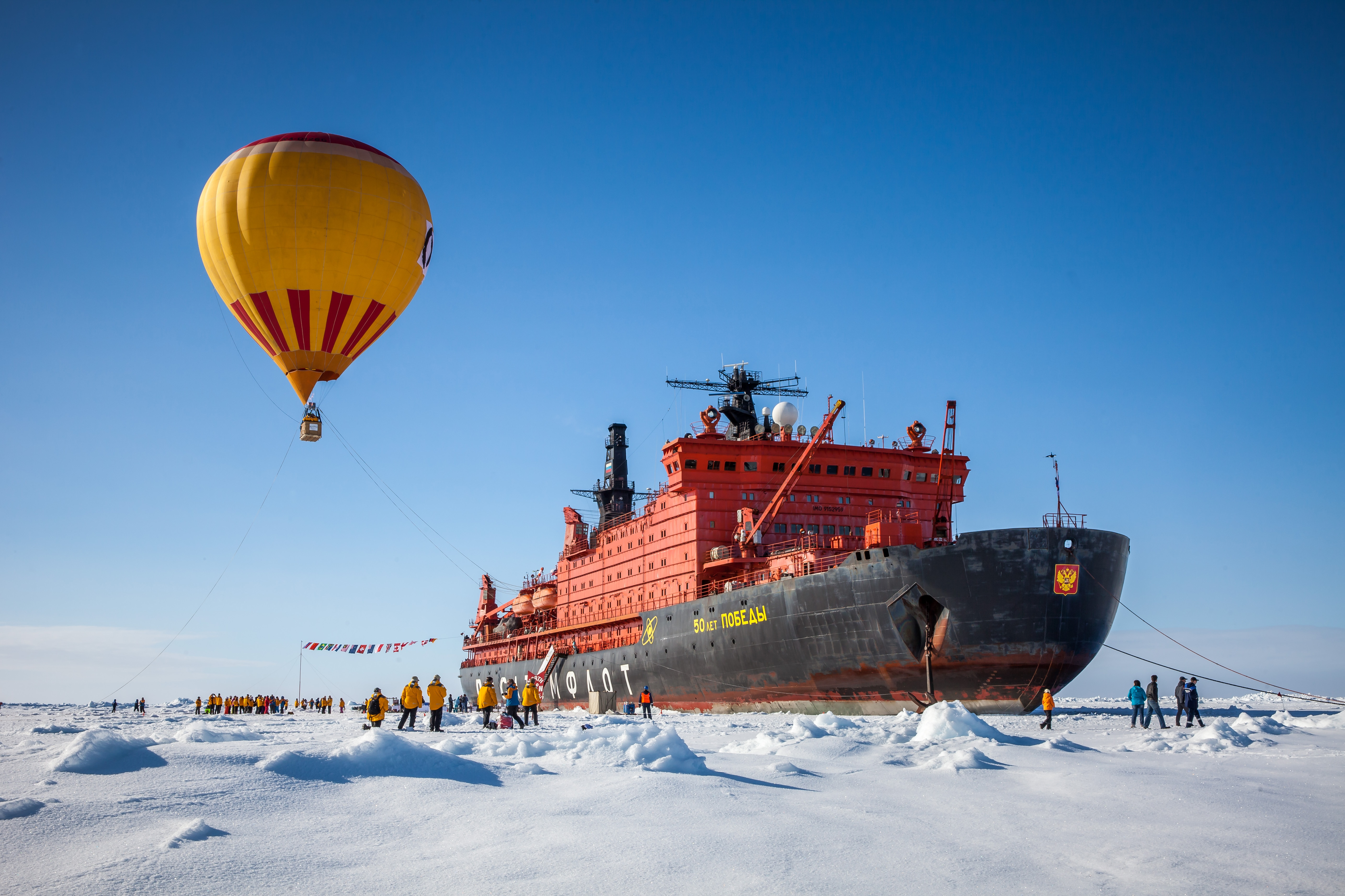 Passengers enjoy a hot air balloon rode over 50 Years of Victory at the North Pole.