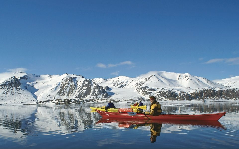 Kayaking the pristine, glass waters of the Arctic is an adventure travel experience like no other.