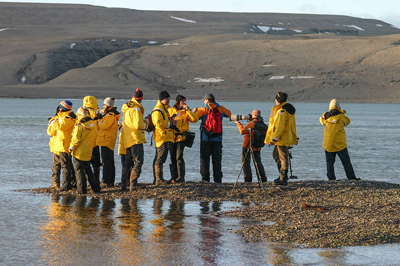 Quark Expeditions travelers taking photos at Arctic Watch