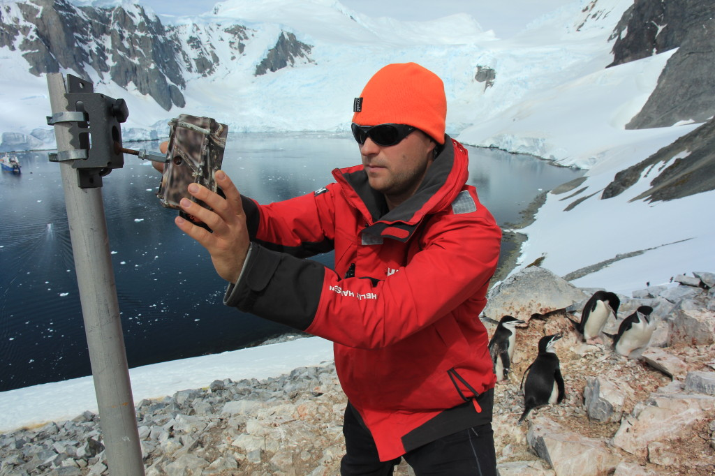 Dr. Tom Hart positions a camera in Antarctica