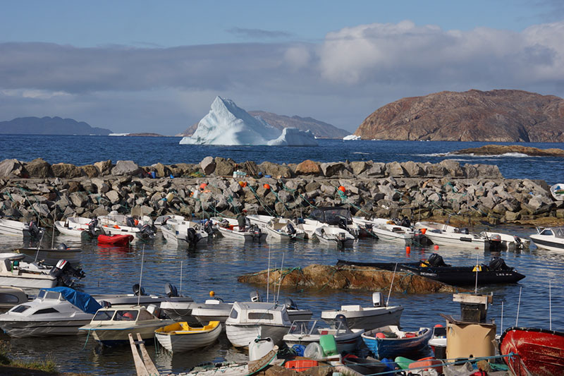 You might see colorful fishing boats in the small town of Upernavik on your Arctic expedition in Greenland.