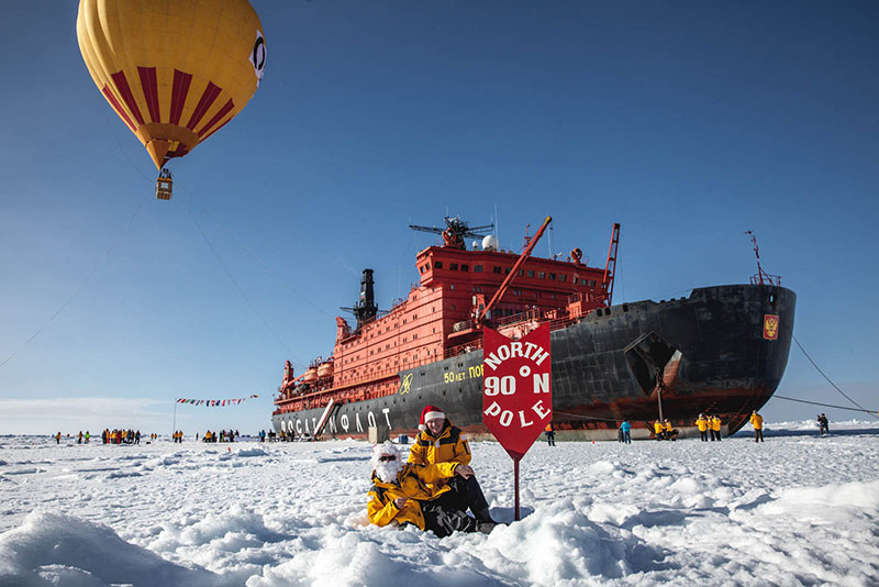 A hot air balloon sails high overhead the icebreaker 50 years of Victory at the North Pole. Photo credit: Samantha Crimmin