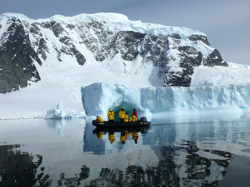 Passengers in Antarctica enjoy the spectacular views from the surface of the water while Zodiac cruising.
