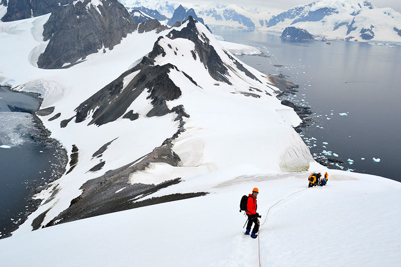 Mountaineering, hiking, Zodiac cruising and other adventurous activities make for physically and mentally rewarding vacations in the polar regions. Photo: Carlo Bellini