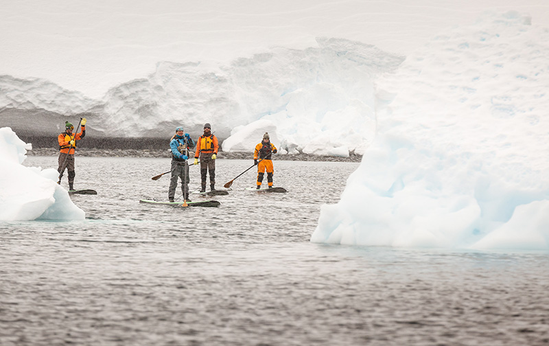 Stand up paddleboarding in Antarctica - credit: Dave Merron