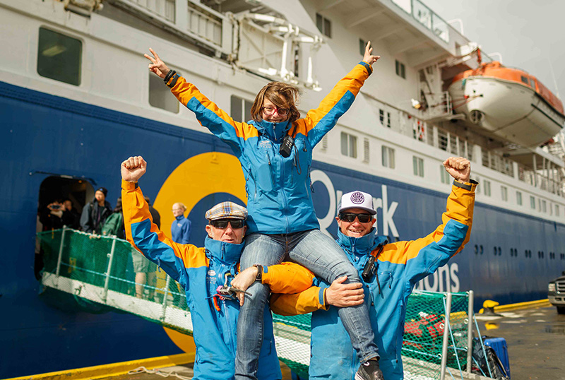 Quark Expeditions Team members welcome guests aboard