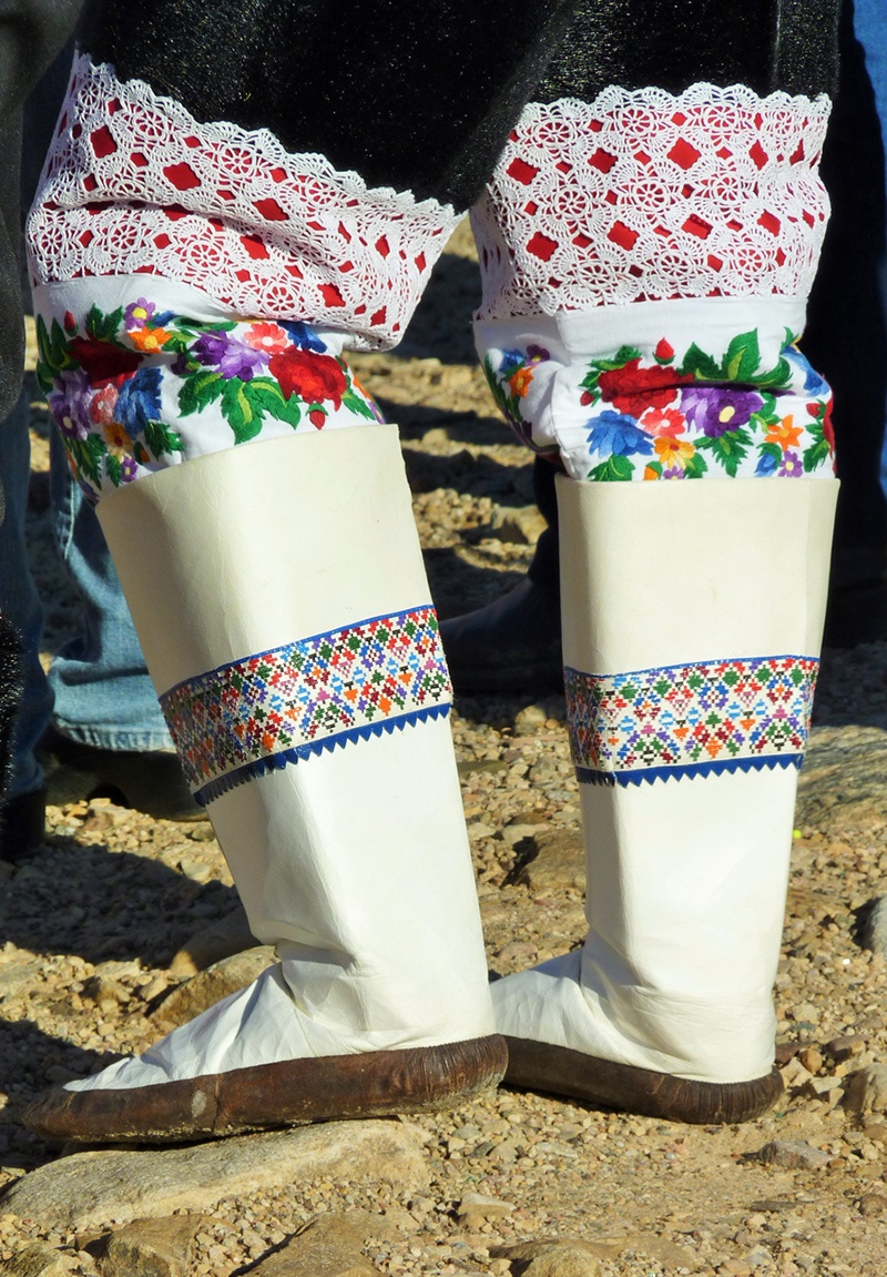 A woman wears traditional Thule boots in an Arctic community.