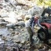 FIXING A FLAT TIRE IN THE BOTTOM OF A CREEK