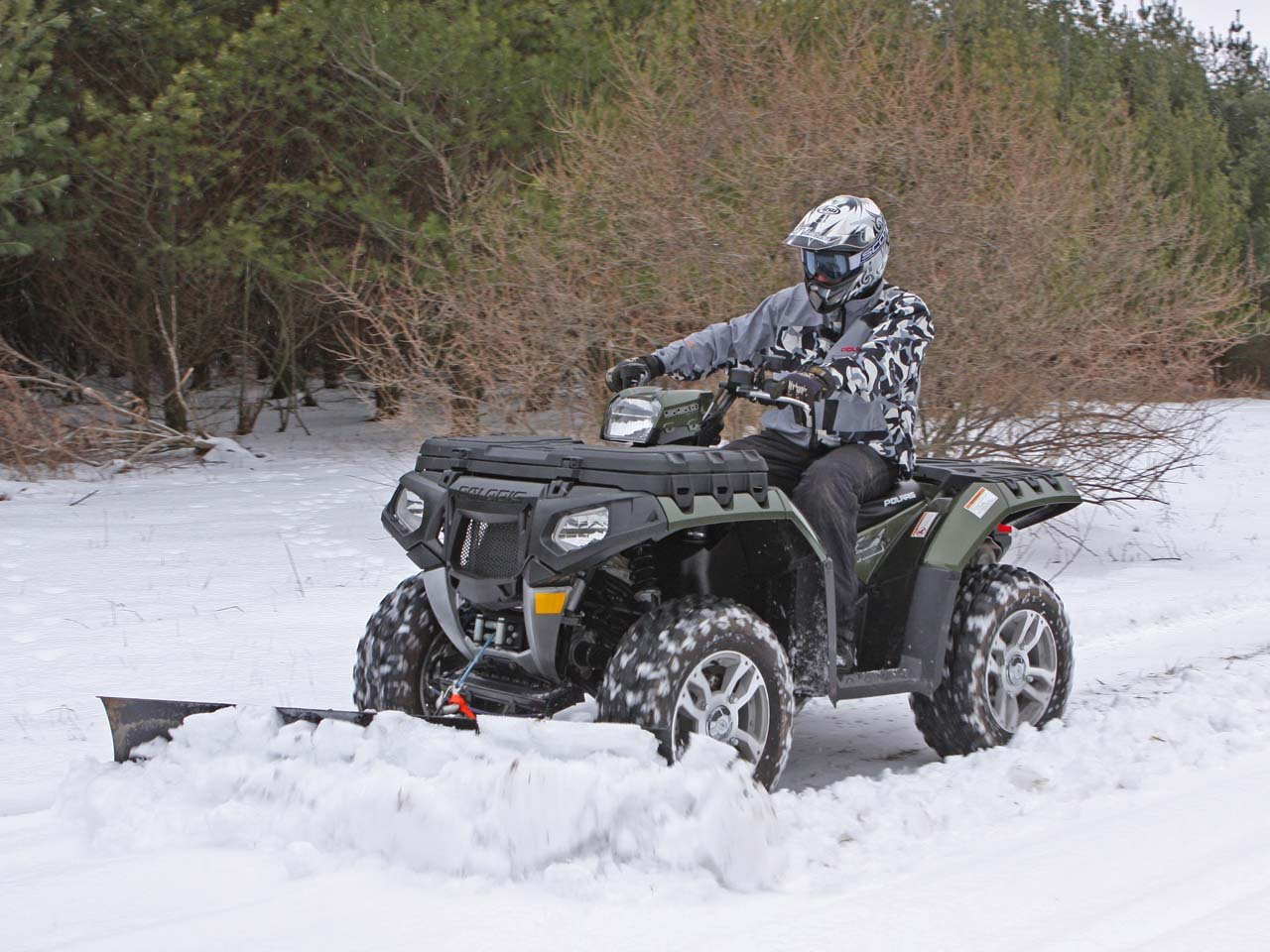 Winter ATV Plowing