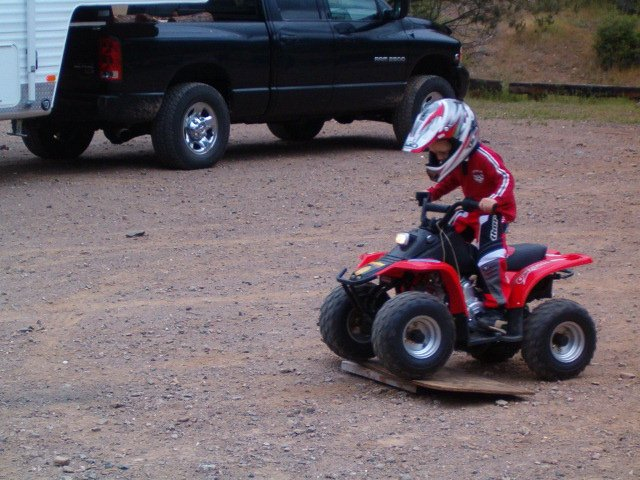 My 3 Yr old....Now he is 4 and Rides a 06 TRX90...