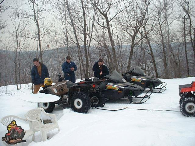 In the snow with snowmobiles