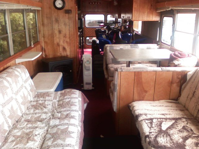 Front half of bus: 2 jack-knife sofas (each sleep 2), dinette (sleeps 2)