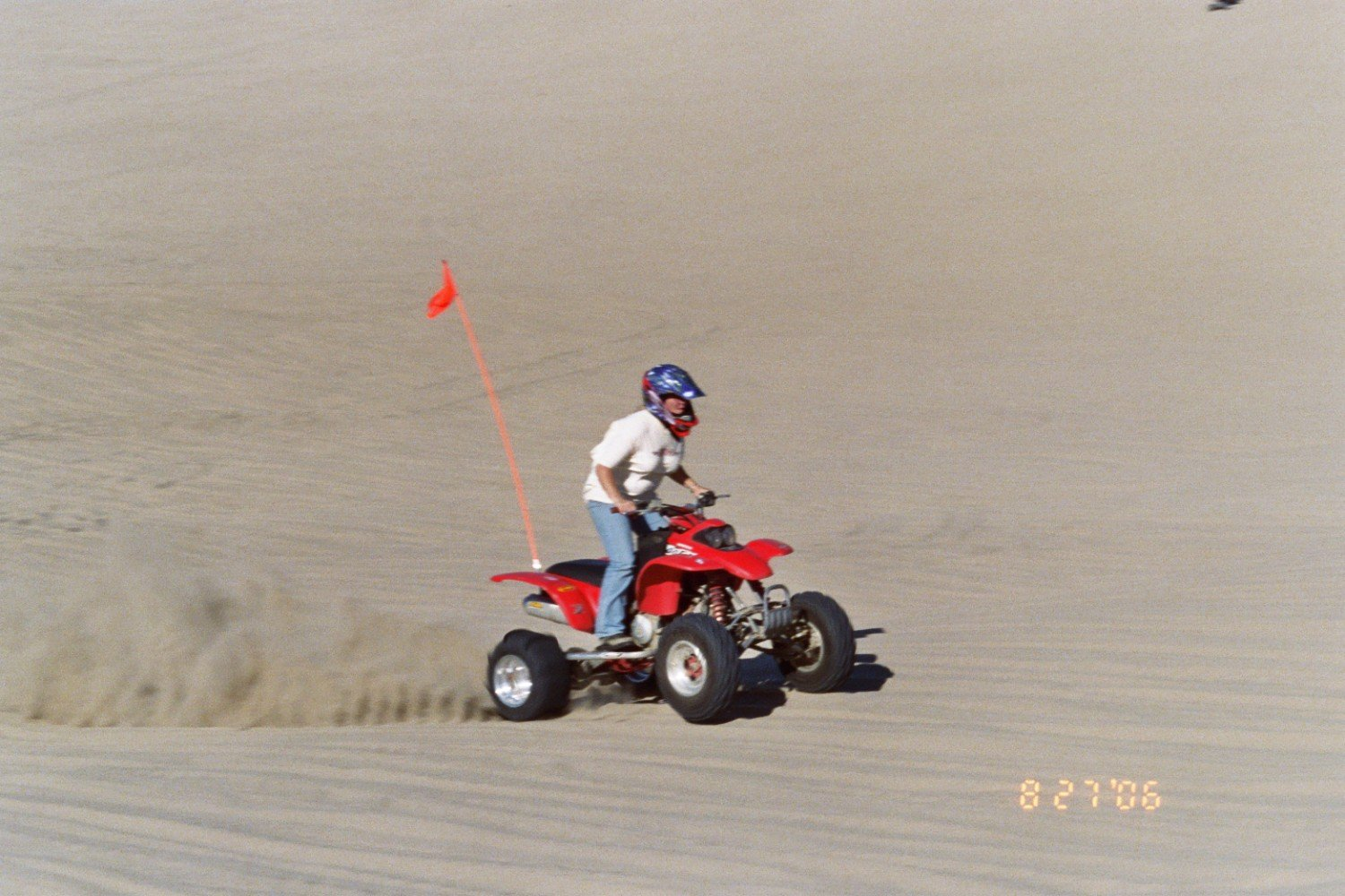 Lindsey on my quad goin' up the bowl @ Sand Lake