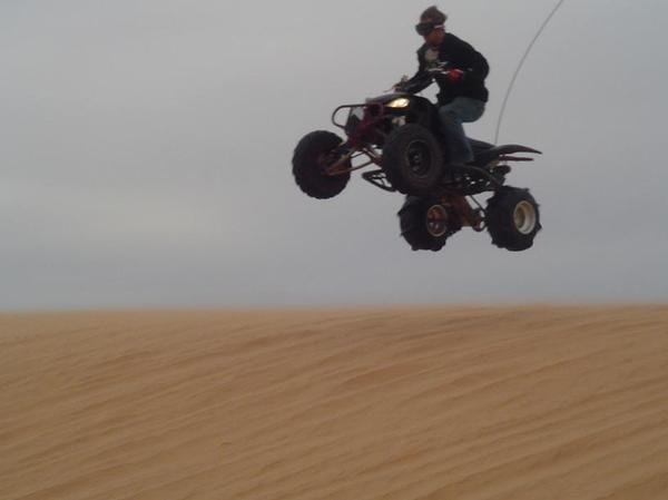 jumping a dune at little sahara