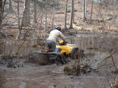 Honda ATV deep in mud and water