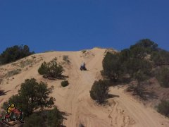 me ridein on a large sand hill on my quad
