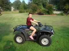 My Daughter & her new quad!