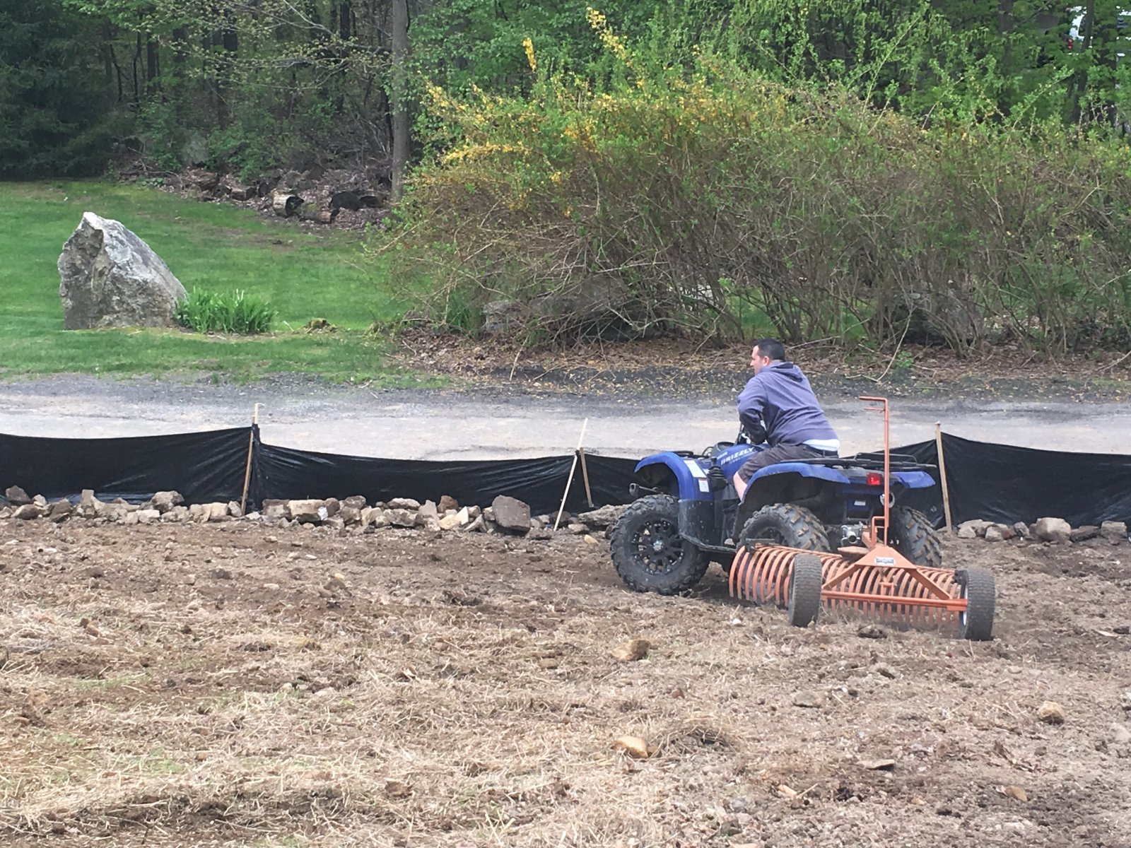 Smoothing out Dirt with ATV Rake