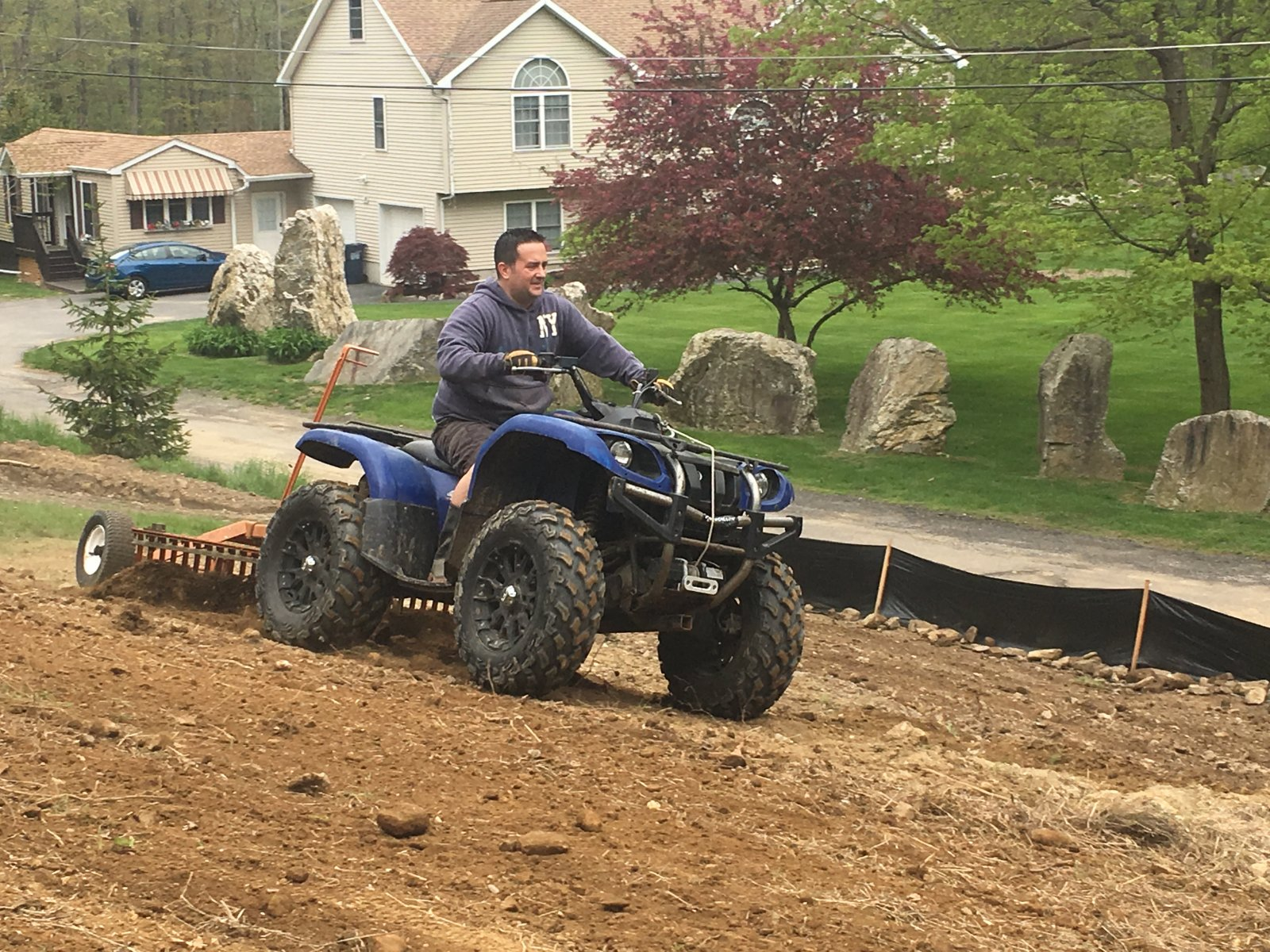 Me on the Grizzly pulling the ATV Rake
