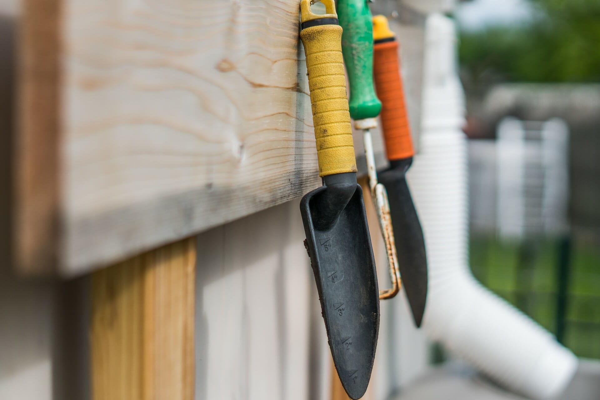 Gardening tools hung on rack