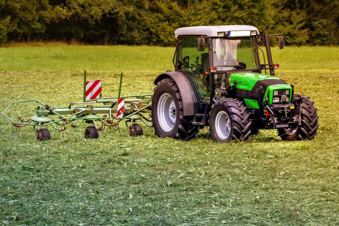 A tractor plowing a field   Rubber products