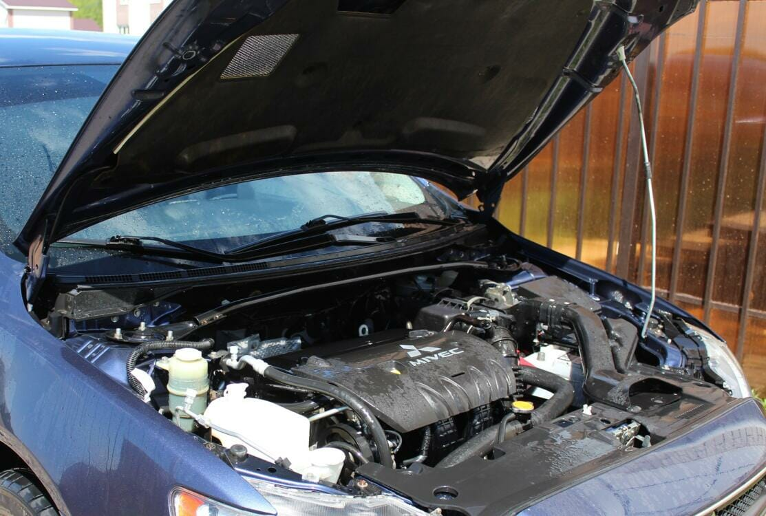 A car with the hood open and exposing the engine   Rubber products