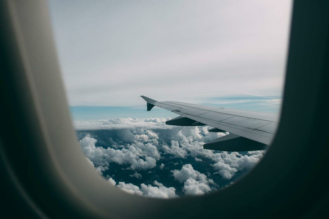 View of airplane wing and top of clouds from window seat | Rubber extrusion process | Window glazing