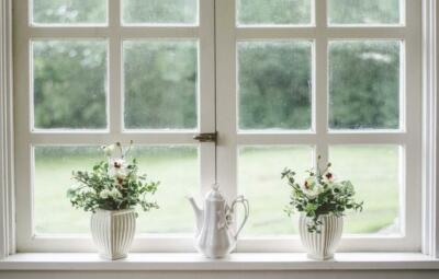 Two, six panel windows with planets in front of them | Window glazing seals