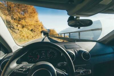 A view of a mountainside road through a windshield | Window rubber seal |