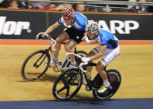 Two cyclists competing in the madison