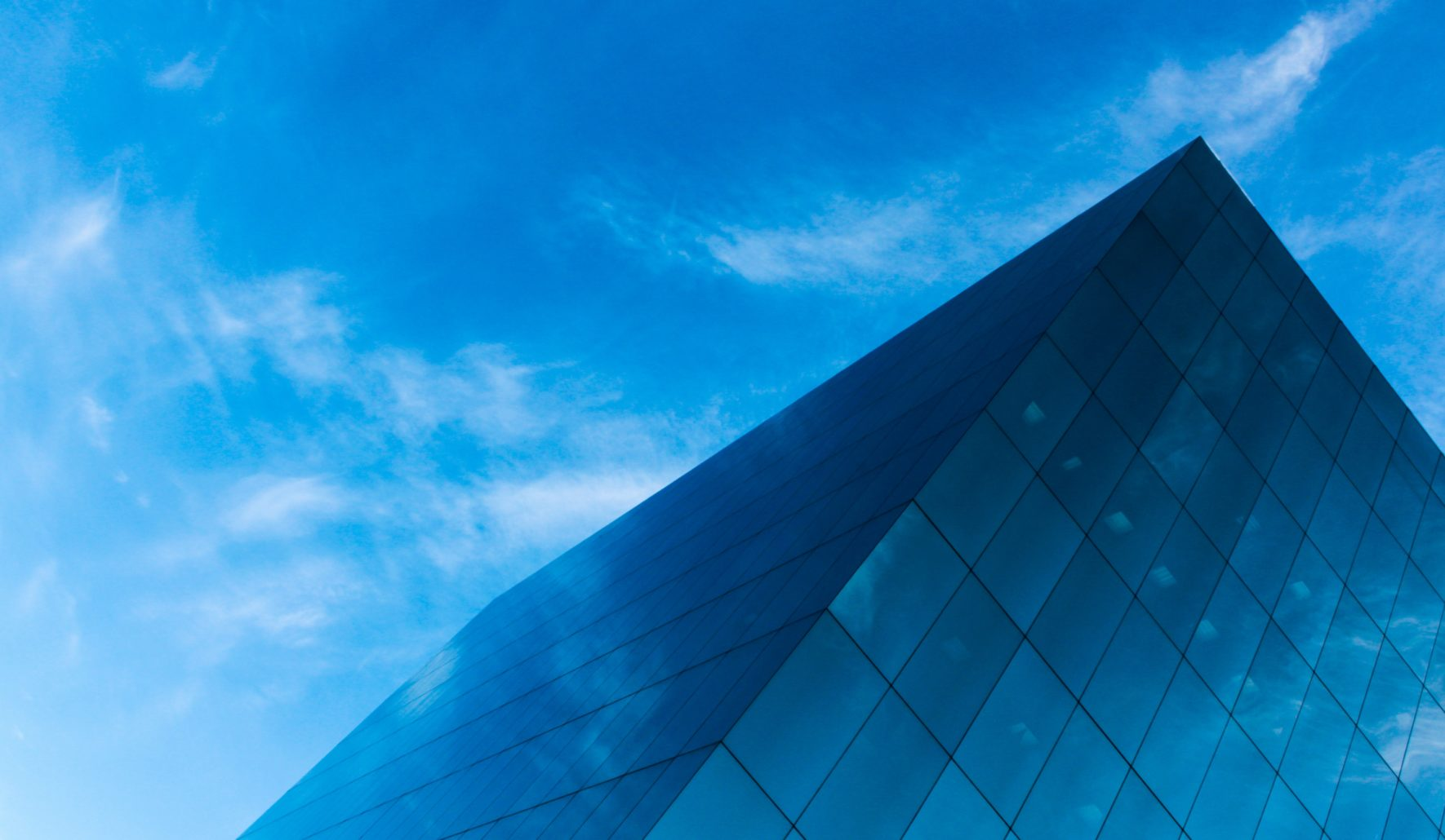 building in the clouds to represent how evaluating HR processes lead to the cloud