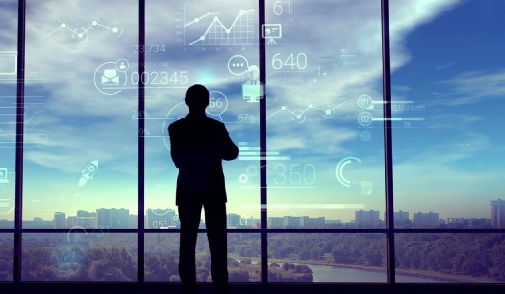 A man stands at the window thinking with data graphics appearing