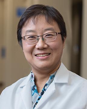 Min Wang, NP
