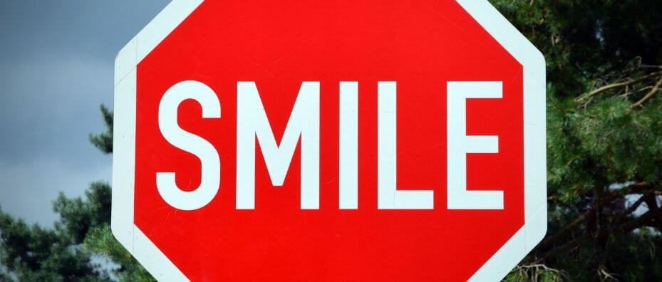 Stop sign that says SMILE