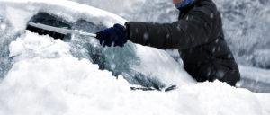 Brushing Snow Off Car