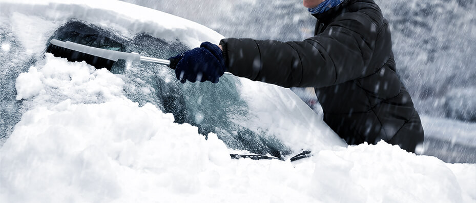 Brushing Snow Off Car