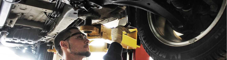 Rad Air Employee Inspecting Shocks
