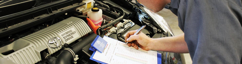 Mechanic checking engine