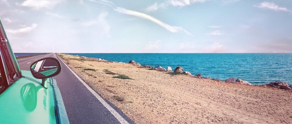 car driving along the sea coast