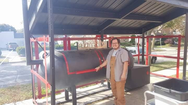 "Aaron Patin with his smoker ""Edna"""